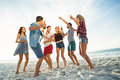 Friends dancing on the beach Royalty Free Stock Photo