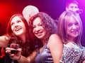 Friends dancing at the party beautiful girls and having fun in nightclub Royalty Free Stock Photo