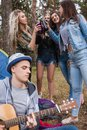 Friends drink rest guitar nature tourism concept. Royalty Free Stock Photo