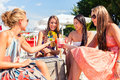 Friends drinking cocktails in beach bar Royalty Free Stock Photo