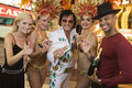 Friends With Elvis Presley Impersonator And Casino Dancers Royalty Free Stock Image