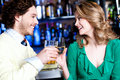 Friends enhoying drinks in nightclub cheerful two celebrating their drink a bar Stock Photo