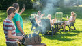 Friends enjoying barbecue in garden group of young a on a sunny afternoon Royalty Free Stock Photos