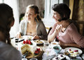 Friends Gathering Together on Tea Party Eating Cakes Enjoyment h Royalty Free Stock Photo