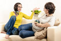 Friends girls coffee home chat happy gesticulating Royalty Free Stock Photo