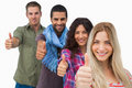 Friends giving thumbs up in a row on white background Royalty Free Stock Image