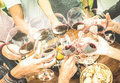 Friends hands toasting red wine glass and having fun outdoors Royalty Free Stock Photo