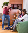 Friends hanging out with beer and jokes smiling russian at home Stock Photo