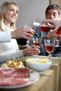 Friends having adinner party an informal dinner Royalty Free Stock Images