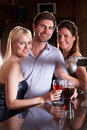 Friends having a drink in bar Royalty Free Stock Photography