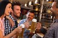 Friends having fun in bar happy young drinking beer pub smiling Royalty Free Stock Images