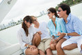 Friends having fun sailing happy group of on a boat Royalty Free Stock Photos