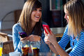Friends having fun with smartphones two Royalty Free Stock Images