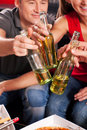 Friends having a party and clinking bottles Stock Photos