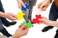 Friends holding colorful jigsaw pieces Royalty Free Stock Photo