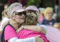 Friends hugging at the end of the race colchester essex uk uk july annual for life event helping to raise money for cancer Stock Image