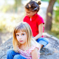 Friends kid girls playing in forest rock Royalty Free Stock Images