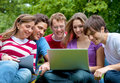 Friends with laptop outdoors Royalty Free Stock Photo
