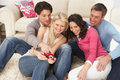Friends Looking At Pictures On Digital Camera Royalty Free Stock Image
