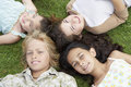 Friends lying together on grass high angle view of with their head Royalty Free Stock Photography