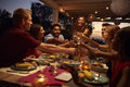 Friends make a toast at a dinner party on a patio, close up Royalty Free Stock Photo