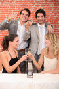 Friends making a toast to great year Stock Photography