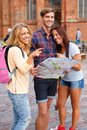 Friends with map three tourist outdoors Stock Image