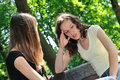 Friends - one teenage girl comforts another Royalty Free Stock Photos