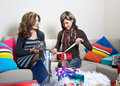 Friends Opening/Preparing Christmas Presents Royalty Free Stock Photography