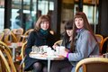 Friends in a parisian street cafe together Royalty Free Stock Photos