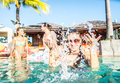 Friends partying swimming pool Royalty Free Stock Photo