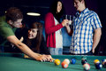 Friends playing billiard Royalty Free Stock Photo