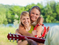 Friends playing guitar Royalty Free Stock Photography