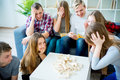 Friends playing jenga Royalty Free Stock Photo