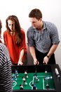 Friends playing table football. Royalty Free Stock Photo