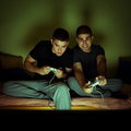 Friends playing video games selected focus on face of men on the right side Stock Image