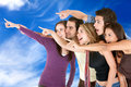 Friends pointing at the sky Royalty Free Stock Photography