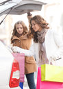 Friends putting goods into the car trunk two beautiful young wo women packing their Royalty Free Stock Image