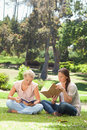 Friends reading their books in the park Royalty Free Stock Image