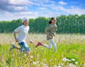 Friends running   in summer Royalty Free Stock Photos