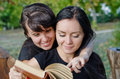 Friends sharing a book Stock Image