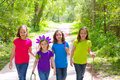 Friends and sister girls walking outdoor in forest track excursion Royalty Free Stock Photos