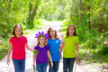 Friends and sister girls walking outdoor in forest track excursion Royalty Free Stock Photography