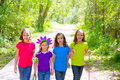 Friends and sister girls walking outdoor in forest track excursion Stock Photos