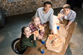 Friends spending time together with pizza and soda drinks, eating pizza at home concept Royalty Free Stock Photo