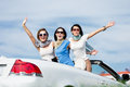 Friends stand in the car with hands up group of girls stands happy journey of joyful teenagers Stock Photography