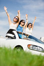 Friends stand in the white car with hands up group of girls stands happy journey of joyful teenagers Royalty Free Stock Photos