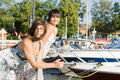 Friends staying near boats Royalty Free Stock Photos