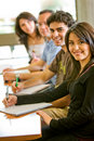 Friends or students smiling Royalty Free Stock Photo