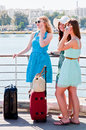 Friends with suitcases young and beautiful women Royalty Free Stock Photos
